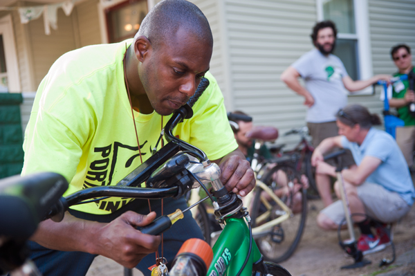 Edison neighborhood's Steve Bostic puts the finishing touches on his bike at the Open Roads Fixapalooza.