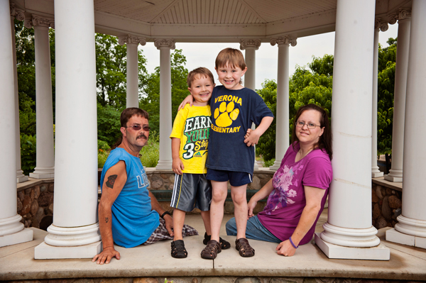 Greg Wesner, left, and Kristy with their kids Corey, 5, and Gregg II, 6.