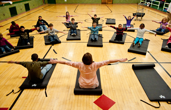 Kids at Prarieview Elementary School participate in morning yoga